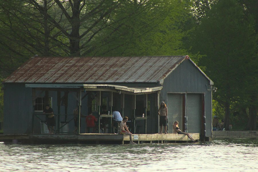 Austinites chill on the dock at Commons Ford Ranch April 10.