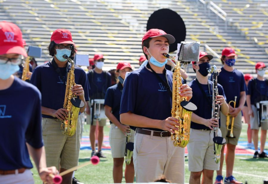 Performing at the Westlake Chaparral Marching Band Showcase Oct. 10, junior Dravin Raj and sophomore Manuel Rosso play the alto saxophone, and junior Mitchell Knipp plays the clarinet.