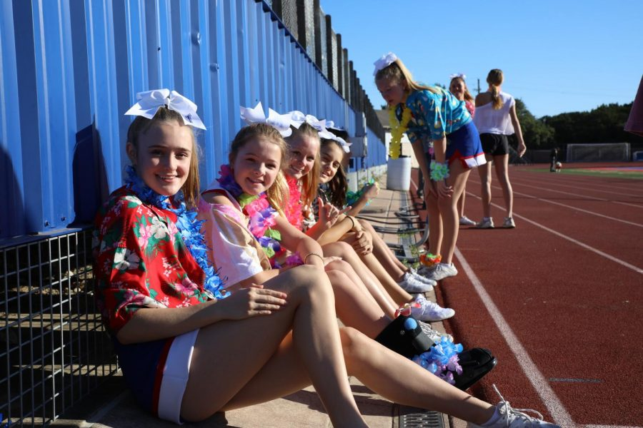 Cheer members freshmen Jonah Johnson, Addie Gates, Claudia Degroot and sophomore Lucy Dennis show off their beach themed attire before the pep rally begins Aug. 24.