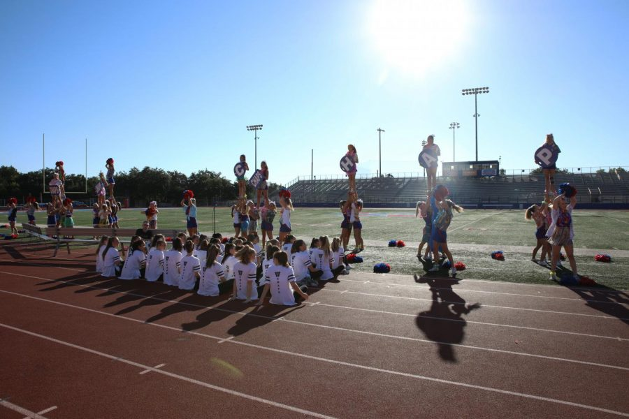 Varsity cheerleaders yell the chap chant during the pep rally Sept. 24.