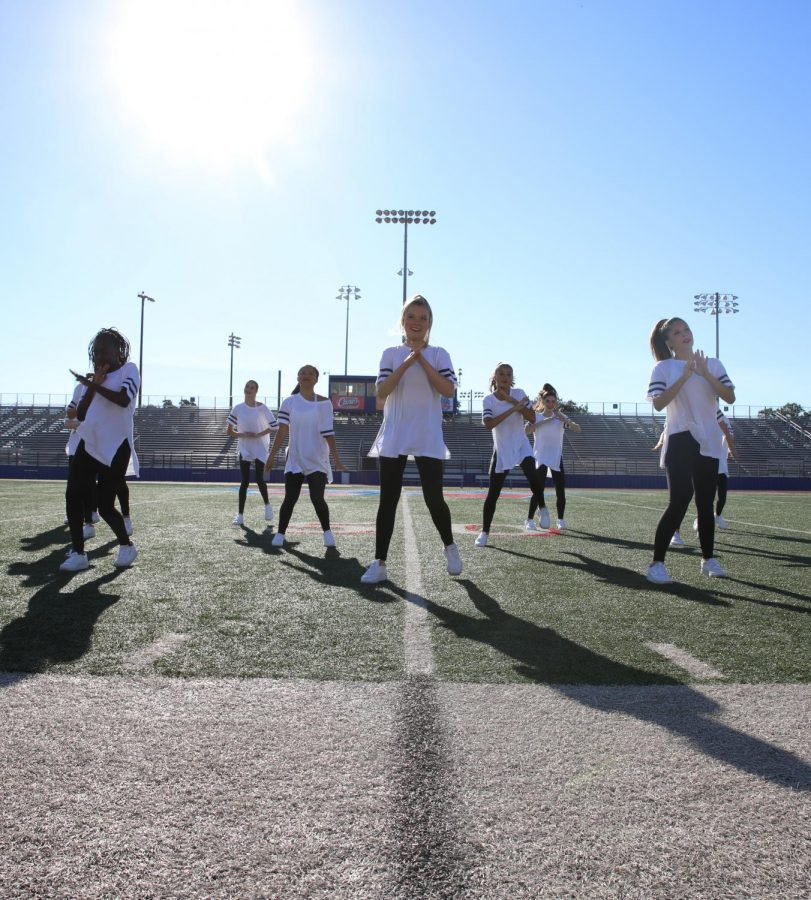 Hyline performs on the stadium field during the pep rally Sept. 24.